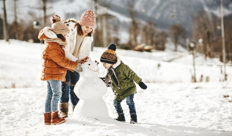 Happy family mother and children having fun on winter walk royalty free stock images