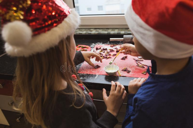 Happy family mother and children son and daughter bake pasta for Christmas royalty free stock photos