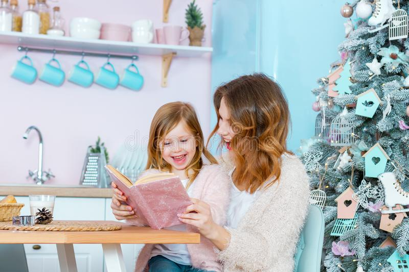 Happy family mother and daughter celebrating Merry Christmas and Happy New Year stock image