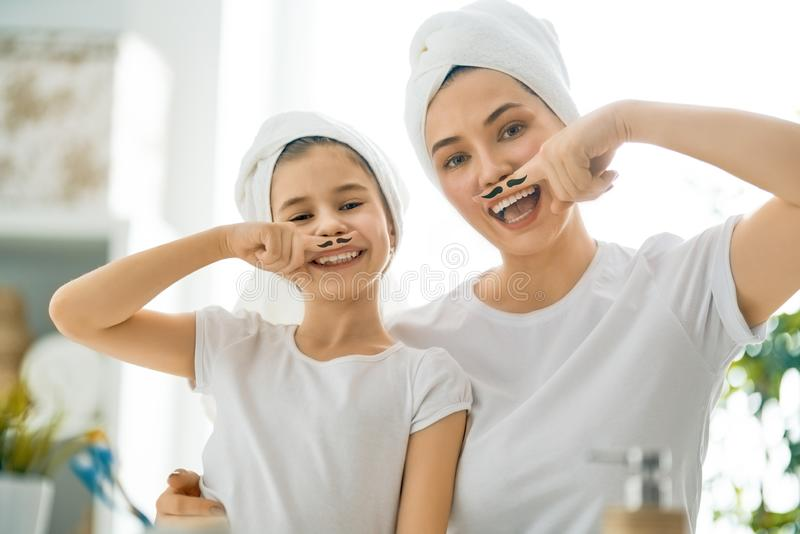 Family in bathroom stock images