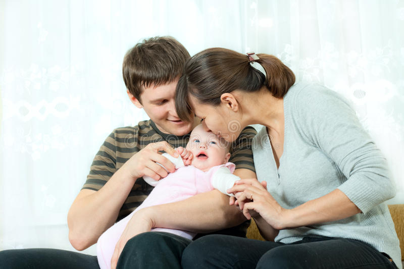 Happy family - mother, father and baby royalty free stock photos