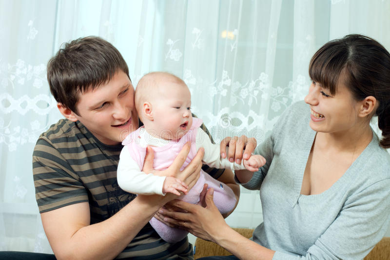 Happy family - mother, father and baby royalty free stock photo