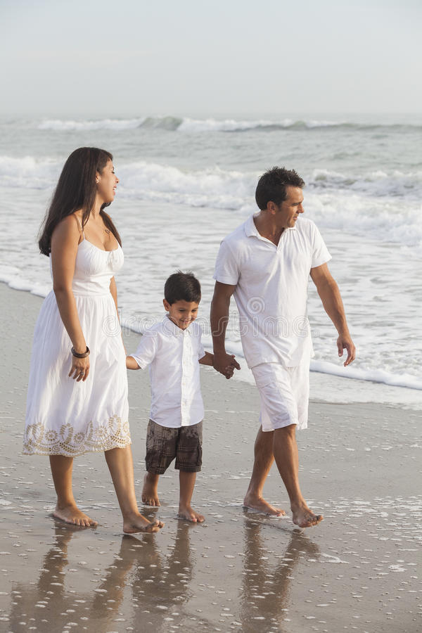 Mother, Father & Boy Child Family Walking on Beach royalty free stock photography