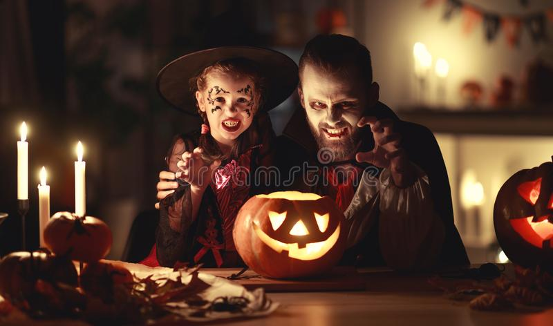 Happy family   father and child daughter in costumes and makeup on  Halloween royalty free stock images