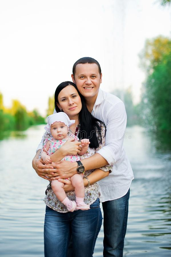 Happy family mother, father, child daughter royalty free stock photography