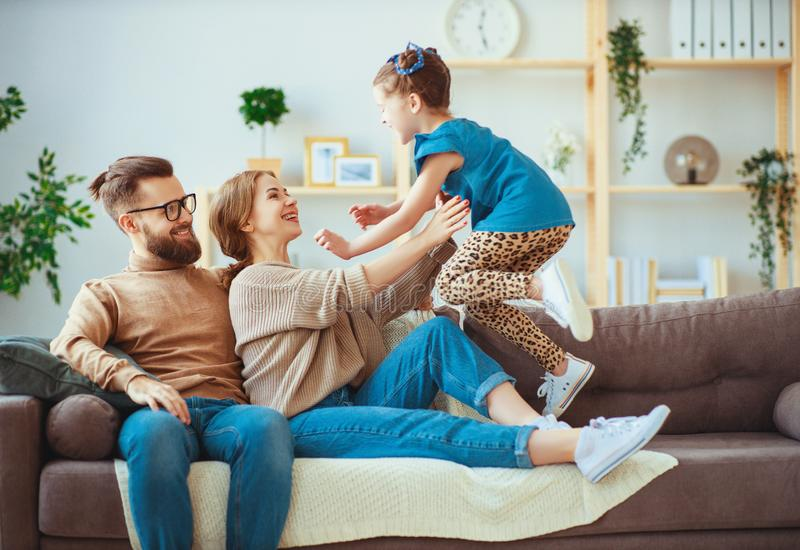 Happy family mother father and child daughter laughing   at home. Happy family mother father and child daughter laughing and havig fun at home stock image