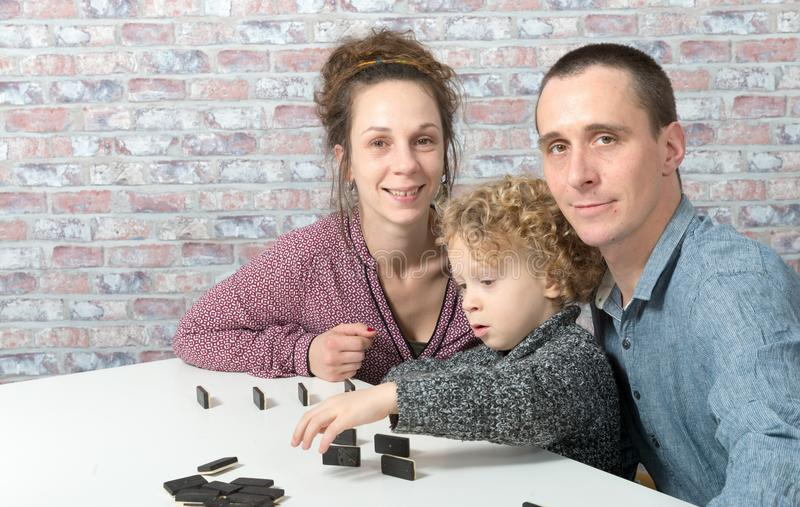 Happy family playing dominos royalty free stock photos