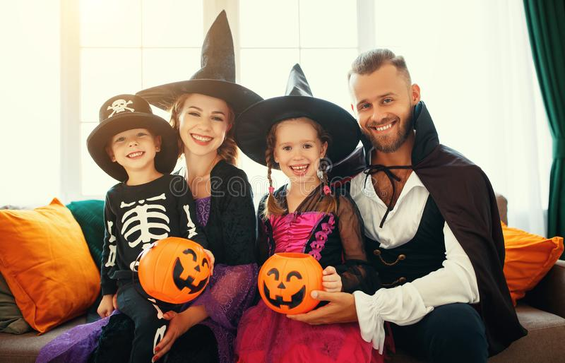 Happy family mother father and children in costumes   on  Halloween royalty free stock images