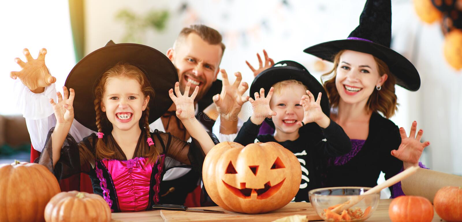 Happy family mother father and children in costumes   on  Halloween. Happy family mother father and children in costumes   on a celebration of Halloween royalty free stock photography