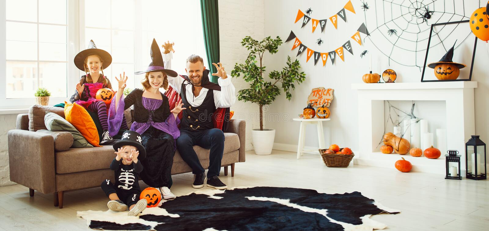 Happy family mother father and children in costumes   on  Halloween. Happy family mother father and children in costumes   on a celebration of Halloween stock photography