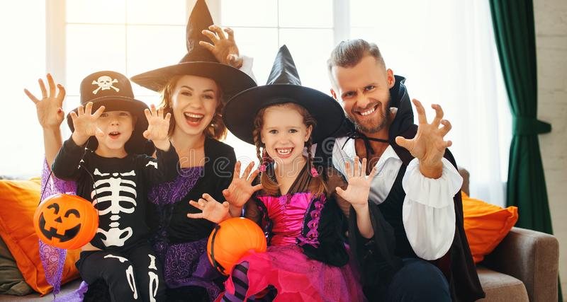 Happy family mother father and children in costumes   on  Halloween royalty free stock photography