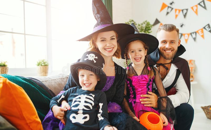 Happy family mother father and children in costumes   on  Halloween. Happy family mother father and children in costumes   on a celebration of Halloween royalty free stock image