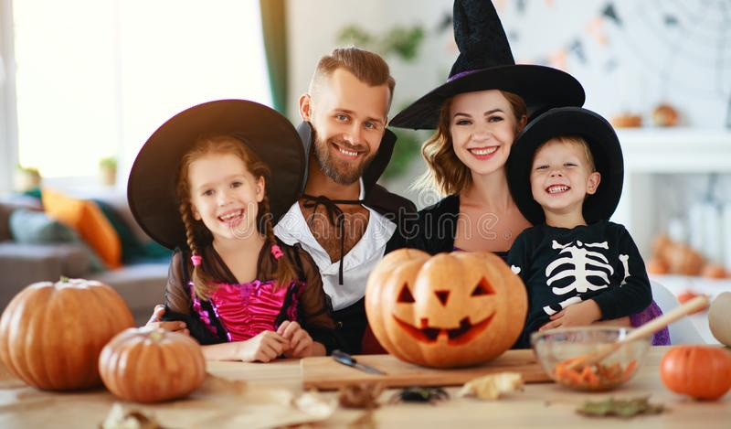 Happy family mother father and children in costumes   on  Halloween royalty free stock photo