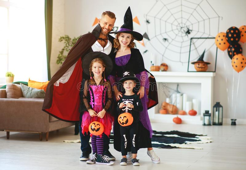 Happy family mother father and children in costumes   on  Halloween. Happy family mother father and children in costumes   on a celebration of Halloween stock image
