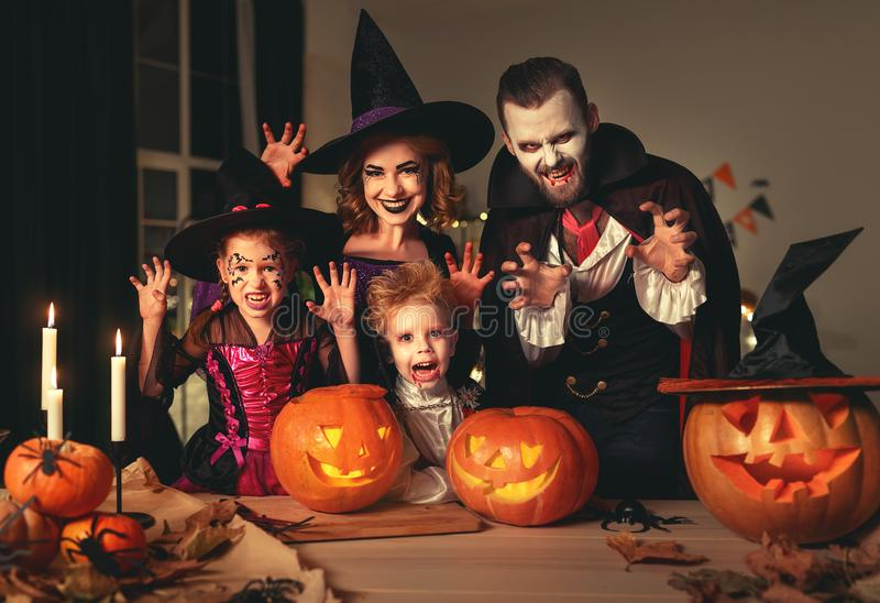 Happy family mother father and children in costumes and makeup on  Halloween stock photography