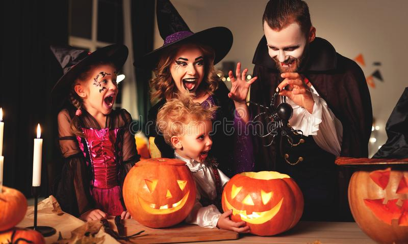 Happy family mother father and children in costumes and makeup on  Halloween stock images