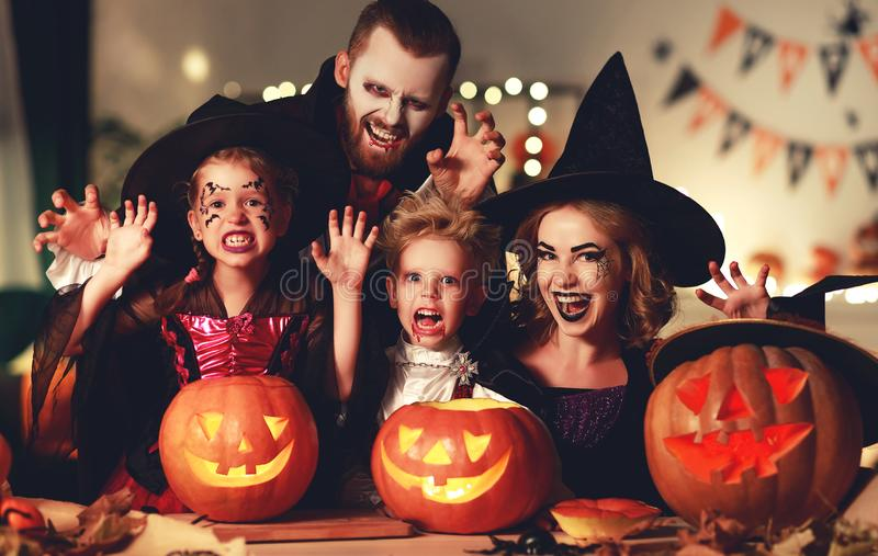 Happy family mother father and children in costumes and makeup on  Halloween stock photo