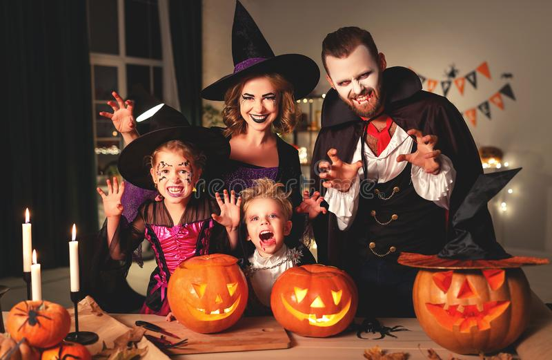 Happy family mother father and children in costumes and makeup on  Halloween. Happy family mother father and children in costumes and makeup on a celebration of stock photography