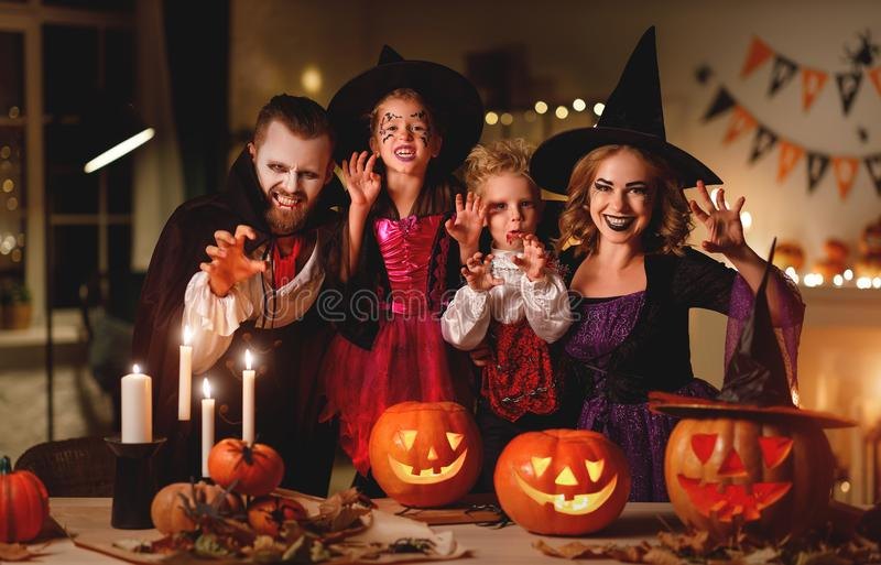 Happy family mother father and children in costumes and makeup on  Halloween. Happy family mother father and children in costumes and makeup on a celebration of royalty free stock photography