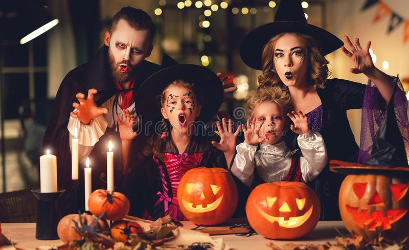 Happy family mother father and children in costumes and makeup on  Halloween. Happy family mother father and children in costumes and makeup on a celebration of royalty free stock photo