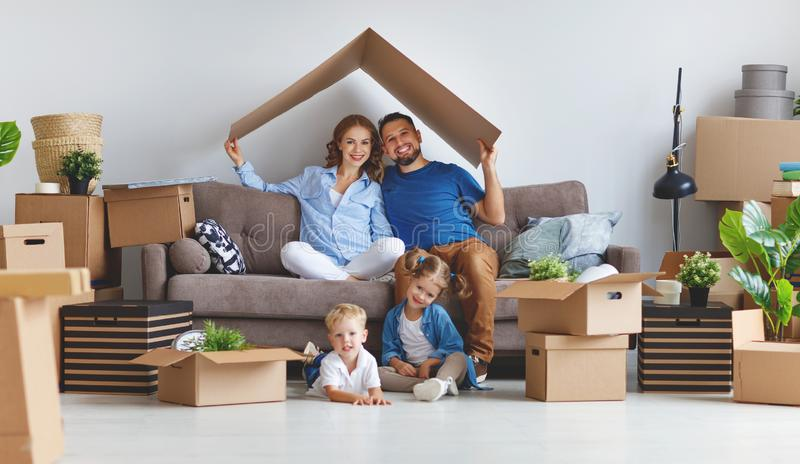 Happy family mother father and children move to new apartment an royalty free stock image