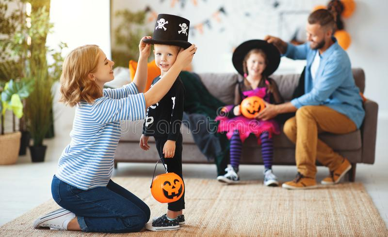 Happy family mother father and children prepare for Halloween in costumes royalty free stock photography