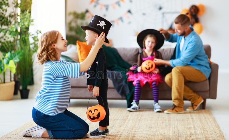 Happy family mother father and children prepare for Halloween in costumes. At home royalty free stock images