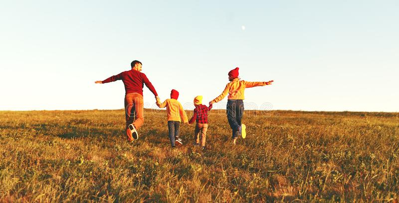 Happy family: mother, father, children son and daughter on autumn sunset royalty free stock image