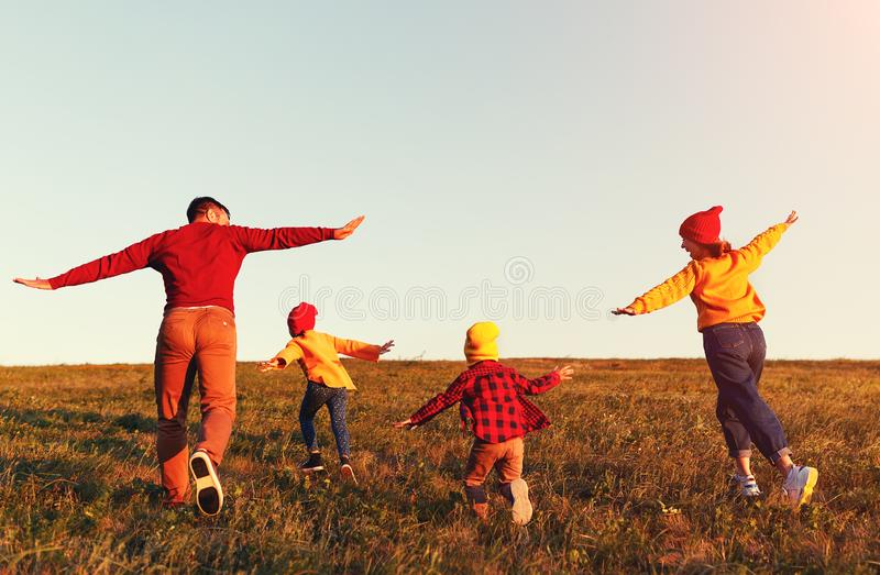 Happy family: mother, father, children son and daughter on autumn sunset stock image