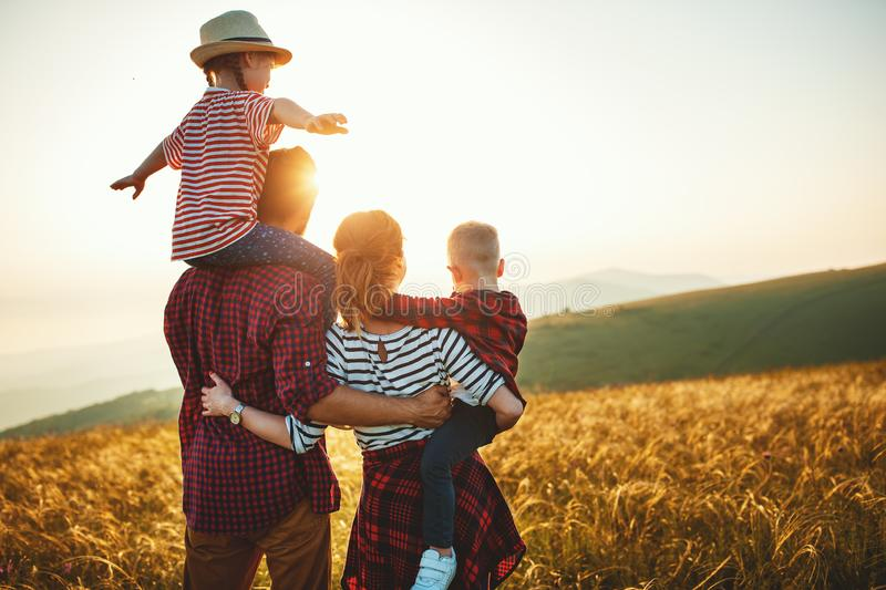 Happy family: mother, father, children son and daughter on sunset royalty free stock photo