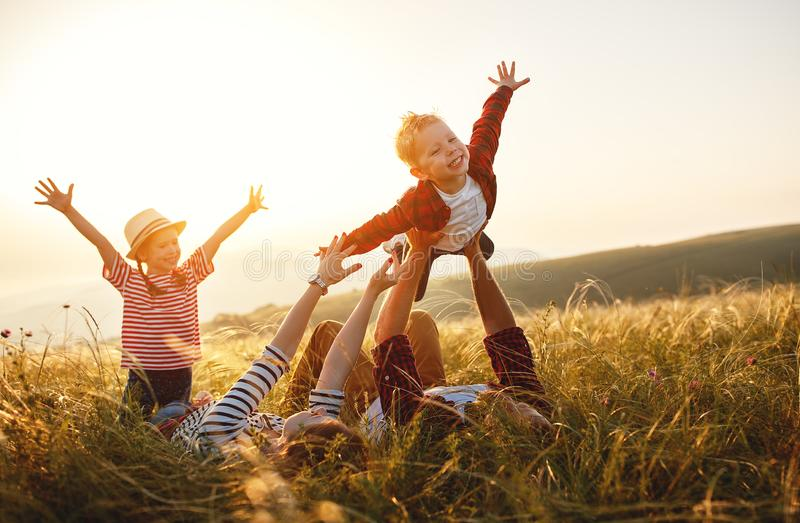 Happy family: mother, father, children son and daughter on sunset stock image