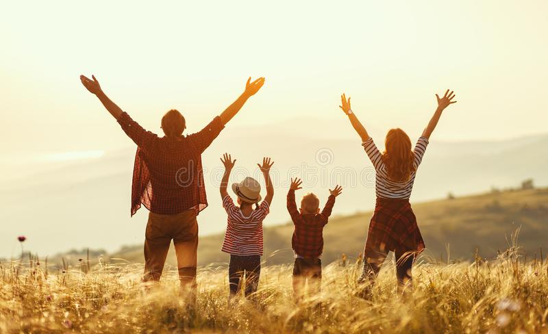 Happy family: mother, father, children son and daughter on sunset royalty free stock photography