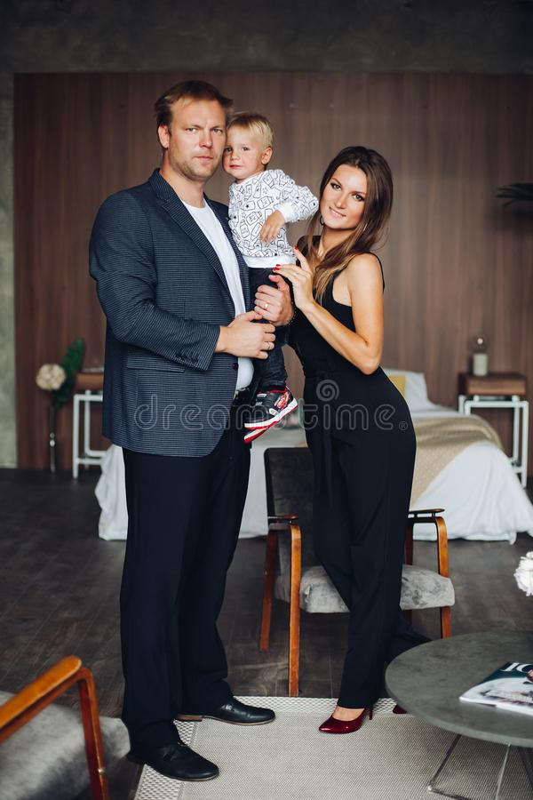 Happy family mother and father playing with a baby at home. royalty free stock photography