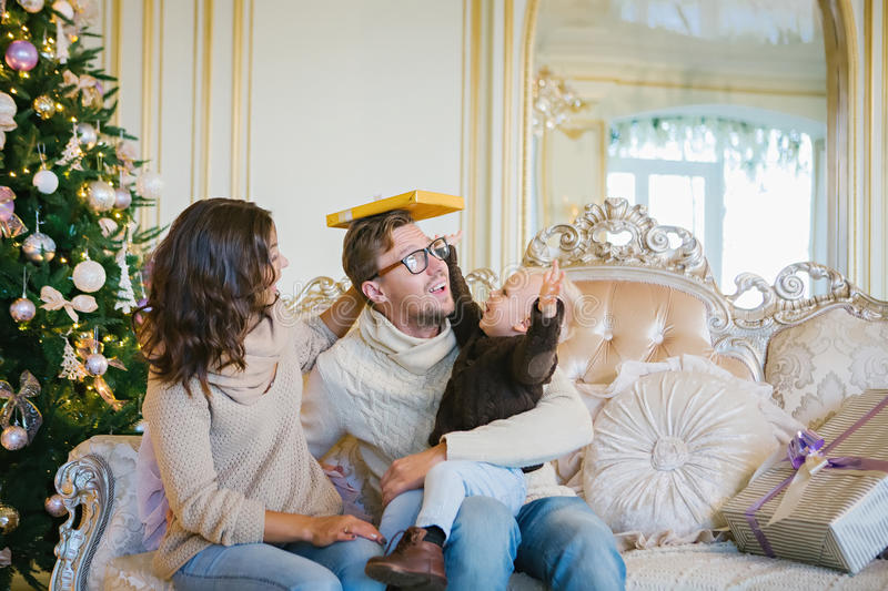 Happy family - mother, father and son are sitting on a sofa royalty free stock photography
