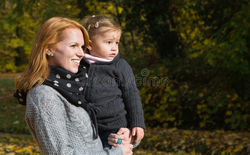 Happy family: mother with her little daughter making a walk in a royalty free stock photography