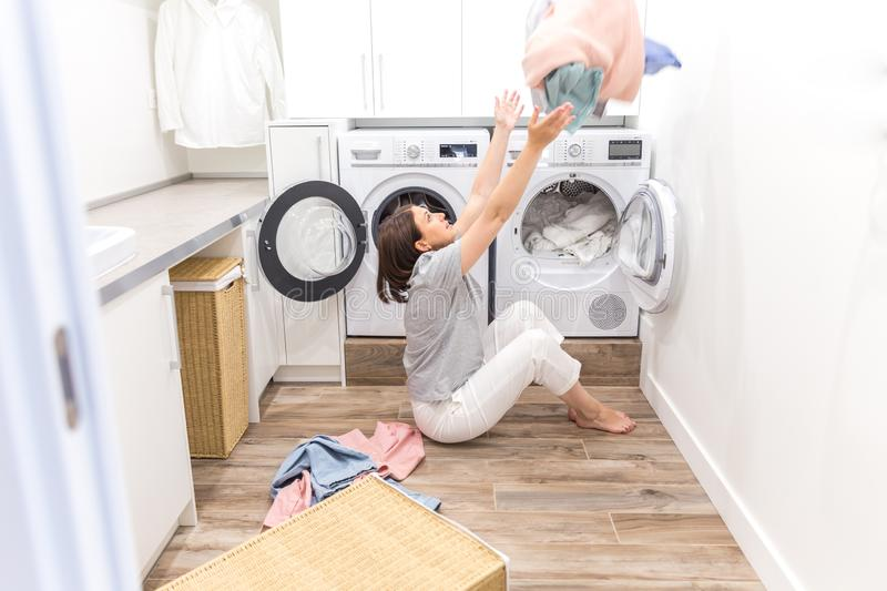 Happy Family Mother Housewife In Laundry Room With Washing Machine