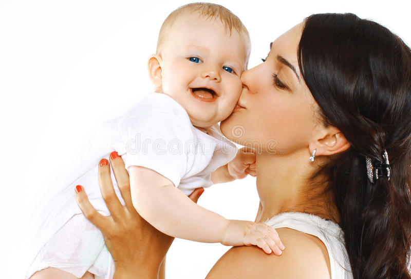 Happy family mother kissing baby stock photos