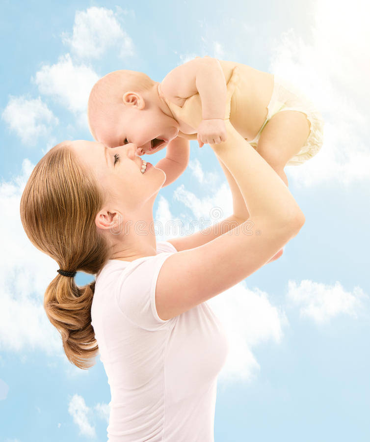 Download Happy Family. Mother Kissing Baby In The Sky Stock Photo - Image: 29611786