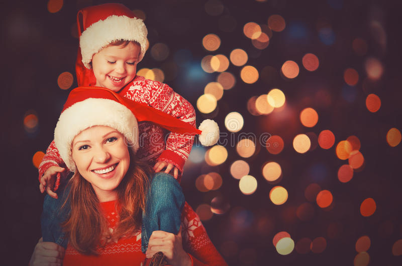 Happy family mother and little child playing in Christmas stock photography