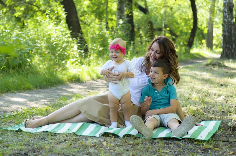 Happy family. Mother with the little daughter and the son have a royalty free stock image
