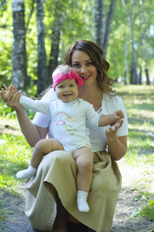Happy family. Mother with the little daughter walk in the park. royalty free stock image