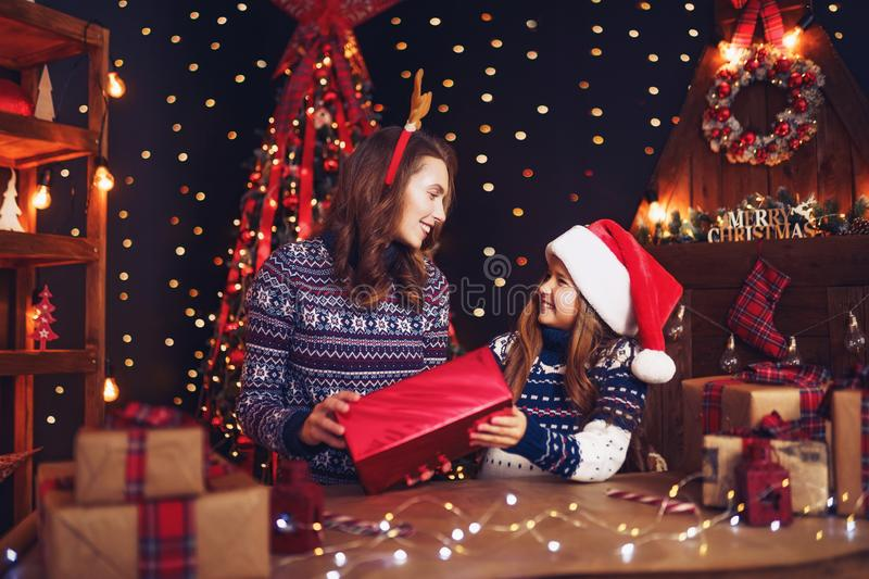 A happy family mother and child pack Christmas gifts royalty free stock image