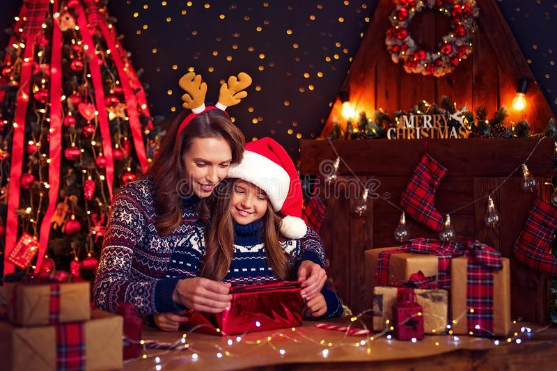 A happy family mother and child pack Christmas gifts royalty free stock images