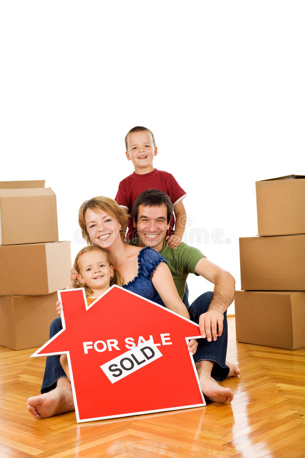 Download Happy Family Moving Into A New Home Stock Photo - Image: 10131438