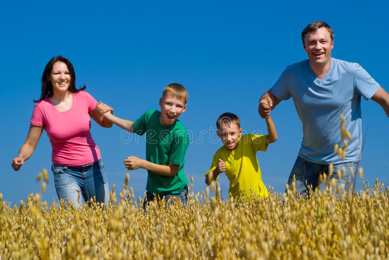 Happy family on the nature stock photos