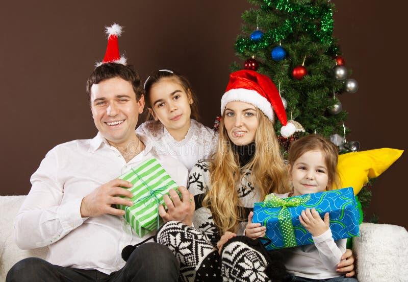 Download Happy Family  Near The Christmas Tree Stock Photo - Image: 26670534