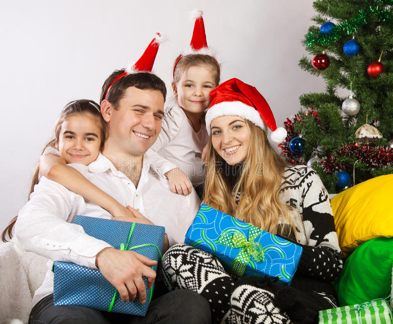 Download Happy Family Near The Christmas Tree Stock Image - Image: 26670583