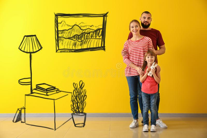 Happy family near color wall stock images