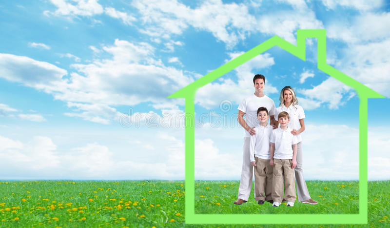 Happy family near new home. stock images