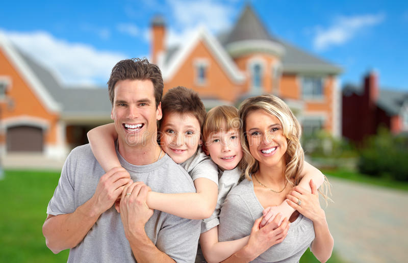 Happy family near new home. stock photos